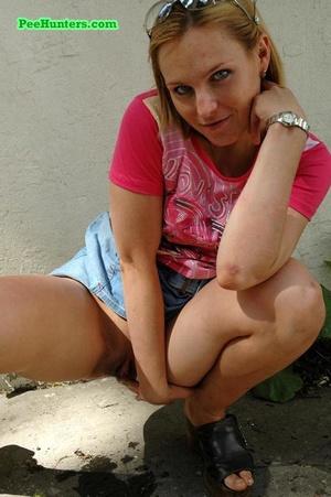 Nasty teen slut takes a piss in the backstreet - XXXonXXX - Pic 16
