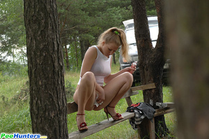 Prankish girl pees onto a bench at a camping site - XXXonXXX - Pic 6