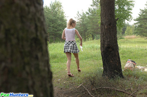 Prankish girl pees onto a bench at a camping site - XXXonXXX - Pic 14