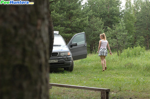 Prankish girl pees onto a bench at a camping site - XXXonXXX - Pic 15