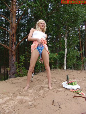 Blonde teen pissing in the beach - XXXonXXX - Pic 15