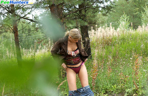 Seductive young girlie drains her bladder outdoors - XXXonXXX - Pic 9
