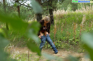 Seductive young girlie drains her bladder outdoors - XXXonXXX - Pic 10