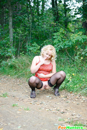 See a nasty smoking ho pissing in the city park - XXXonXXX - Pic 6