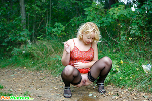 See a nasty smoking ho pissing in the city park - XXXonXXX - Pic 13