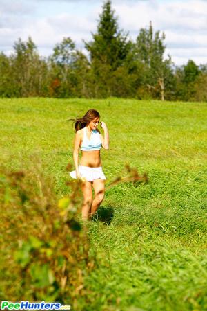 She takes a leak while walking through countryside - XXXonXXX - Pic 1