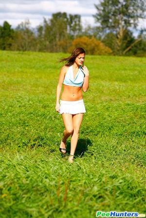 She takes a leak while walking through countryside - XXXonXXX - Pic 2