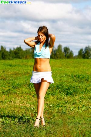 She takes a leak while walking through countryside - XXXonXXX - Pic 4