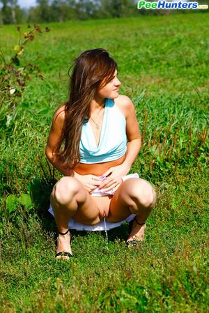 She takes a leak while walking through countryside - XXXonXXX - Pic 7