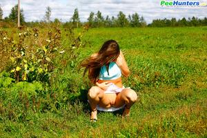 She takes a leak while walking through countryside - XXXonXXX - Pic 8