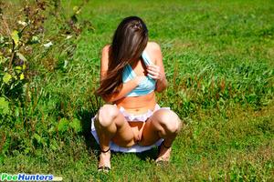 She takes a leak while walking through countryside - XXXonXXX - Pic 9
