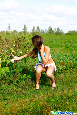 She takes a leak while walking through countryside - XXXonXXX - Pic 12