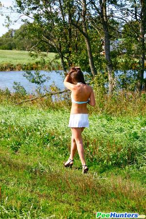 She takes a leak while walking through countryside - XXXonXXX - Pic 15