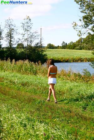 She takes a leak while walking through countryside - XXXonXXX - Pic 16