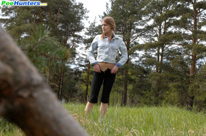 Shameless young tart caught peeing on forest path - XXXonXXX - Pic 4