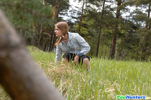 Shameless young tart caught peeing on forest path - XXXonXXX - Pic 6