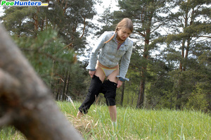 Shameless young tart caught peeing on forest path - XXXonXXX - Pic 14