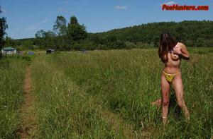 Beautiful teen peeing on the field - XXXonXXX - Pic 3