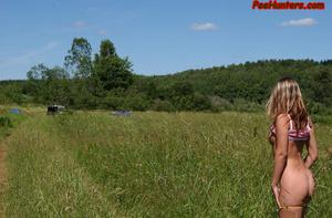Beautiful teen peeing on the field - XXXonXXX - Pic 7