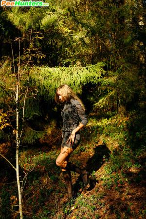 Exclusive spy photos of a cute girl peeing in the bush - XXXonXXX - Pic 14