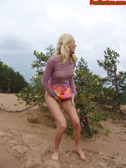 Beautiful teen peeing in the beach - XXXonXXX - Pic 15