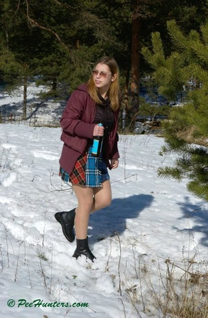 Teen peeing in the snow forest - XXXonXXX - Pic 1
