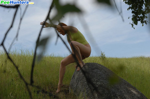 Babe tinkles on a rock in the middle of a field - XXXonXXX - Pic 8