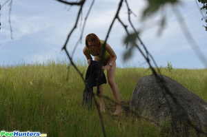 Babe tinkles on a rock in the middle of a field - XXXonXXX - Pic 9