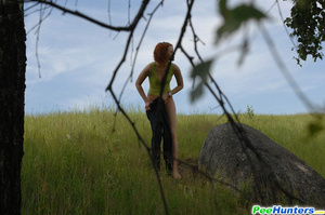 Babe tinkles on a rock in the middle of a field - XXXonXXX - Pic 10