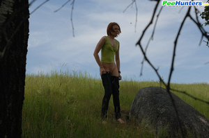 Babe tinkles on a rock in the middle of a field - XXXonXXX - Pic 11