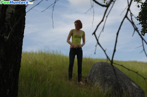 Babe tinkles on a rock in the middle of a field - XXXonXXX - Pic 12
