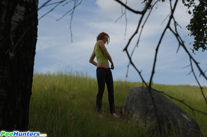 Babe tinkles on a rock in the middle of a field - XXXonXXX - Pic 13