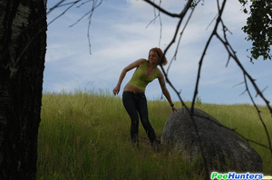 Babe tinkles on a rock in the middle of a field - XXXonXXX - Pic 14
