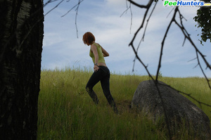 Babe tinkles on a rock in the middle of a field - XXXonXXX - Pic 15