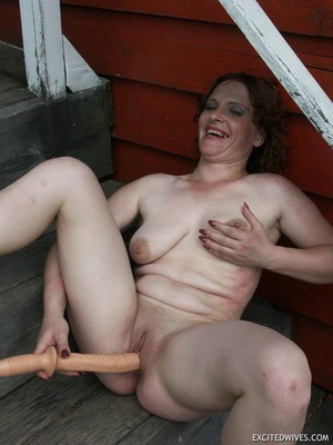 Busty mature wife toying her pussy with huge dildo outdoors. Tags: Insertion, brunette, shaved pussy, homemade. - XXXonXXX - Pic 4