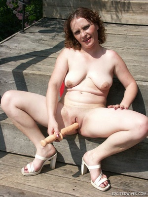 Busty mature wife toying her pussy with huge dildo outdoors. Tags: Insertion, brunette, shaved pussy, homemade. - XXXonXXX - Pic 8