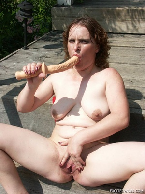 Busty mature wife toying her pussy with huge dildo outdoors. Tags: Insertion, brunette, shaved pussy, homemade. - XXXonXXX - Pic 9