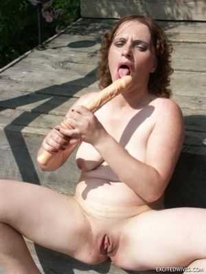 Busty mature wife toying her pussy with huge dildo outdoors. Tags: Insertion, brunette, shaved pussy, homemade. - XXXonXXX - Pic 10