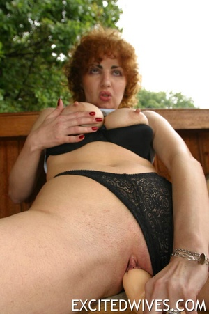 Awesome dildo fuck action performed by redhead mature wife. Tags: Insertion, homemade, shaved vagina, huge melons. - XXXonXXX - Pic 3