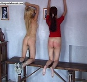 Beuatiful redhead undressed and spanked on a…