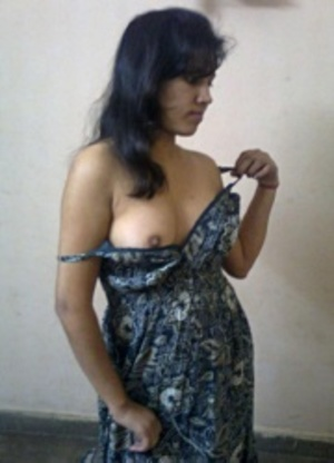 Indian amateur chick slowly slips out her tight dress and showing her yummy tits. - XXXonXXX - Pic 2