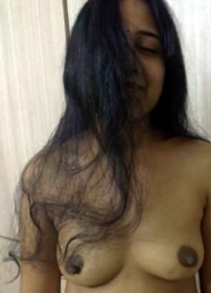 Indian amateur chick slowly slips out her tight dress and showing her yummy tits. - XXXonXXX - Pic 9