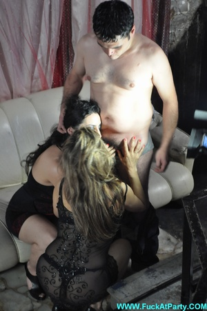 Reality orgy party pics of two nasty nymphs in black outfits undressing and blowing lucky guy. - XXXonXXX - Pic 10