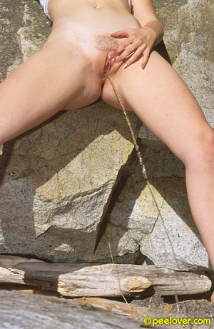 Having made herself comfortable on the rocks, the lovely is going pee upon her own underpinnings! - XXXonXXX - Pic 3