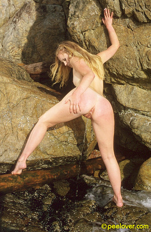 Having made herself comfortable on the rocks, the lovely is going pee upon her own underpinnings! - XXXonXXX - Pic 7