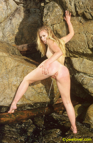 Having made herself comfortable on the rocks, the lovely is going pee upon her own underpinnings! - XXXonXXX - Pic 8
