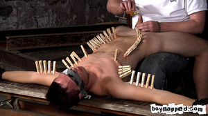 Squeezing all his limbs and buttocks with gay men clothes pins! - XXXonXXX - Pic 4