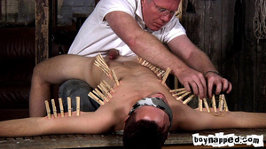 Squeezing all his limbs and buttocks with gay men clothes pins! - XXXonXXX - Pic 6