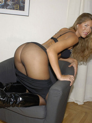 Awesome woman Jennifer in black underwear cut her pantyhose open to sh.. - picture 5