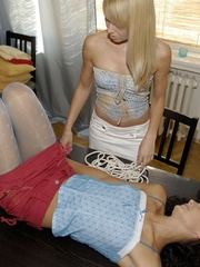 Curly hair Andy in blue pantyhose luing on the table and has her nippl.. - picture 2